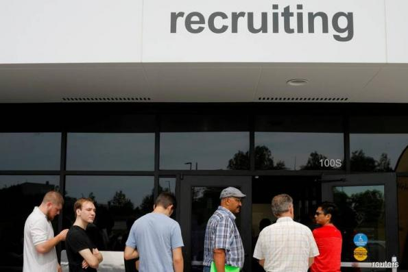 U.S. weekly jobless claims drop as labor market picks up steam