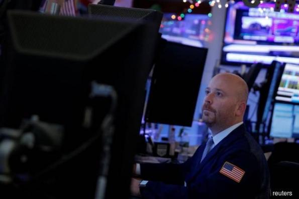 U.S. stocks fall fifth day as treasuries retreat