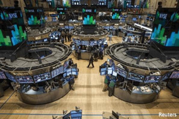 Wall St slips as financials, discretionary stocks drag