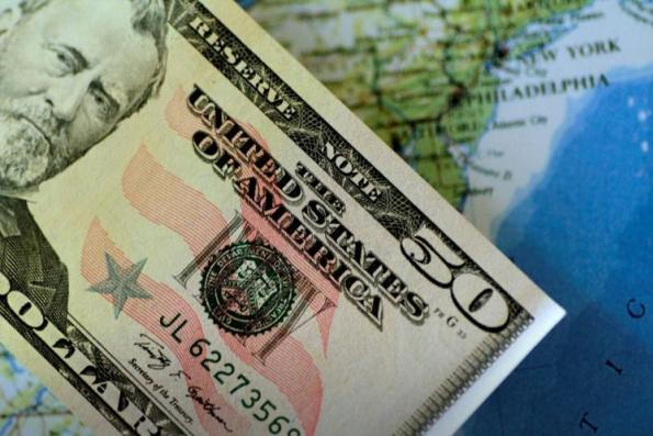 Dollar falls on worries over possible US government shutdown