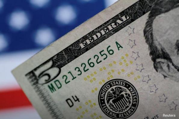 US dollar gains as tensions simmer, rate hike outlook improves