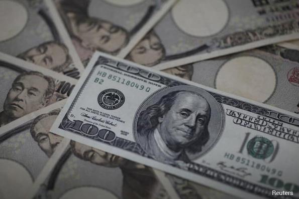 Dollar edges up vs yen on 'gotobi' payment date, faces summit pressure