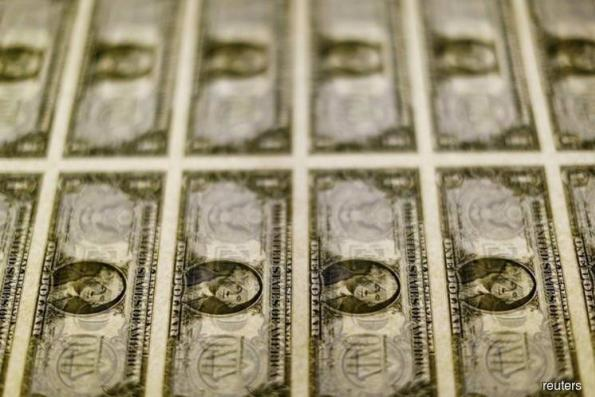 Dollar inches higher, Fed's rate projections in focus