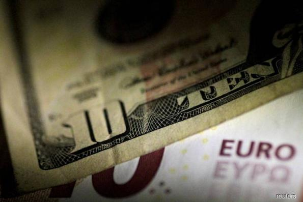 Dollar drops off 11-month high; sterling bounces after hawkish BOE