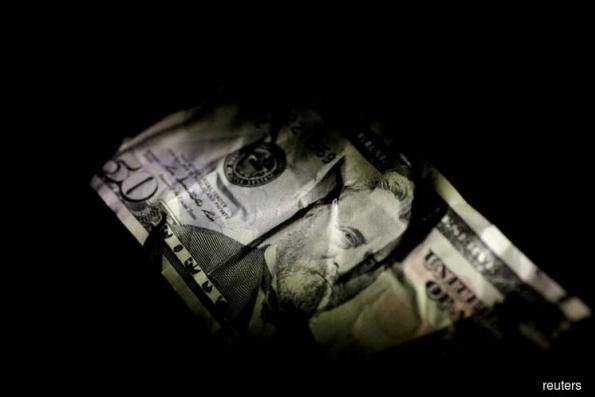 Dollar holds gains vs yen, trade worries linger as China PMI looms