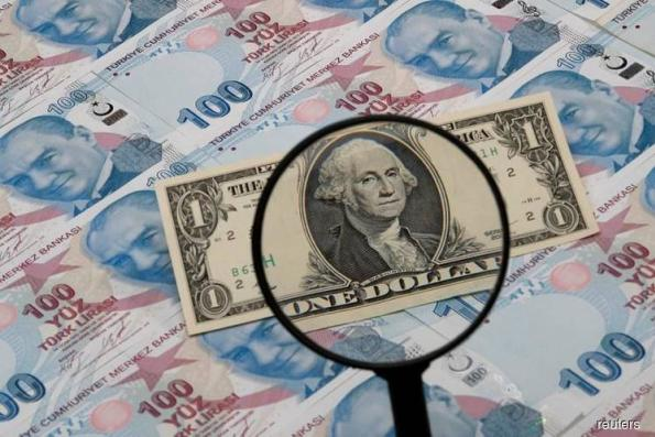 Dollar sags after weak U.S. data, Turkey rate hike lifts emerging currencies