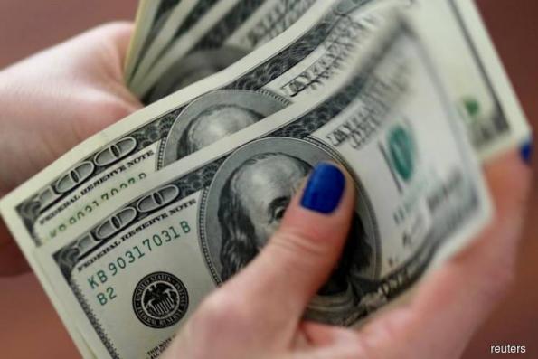 Dollar near 7-week low as markets look past trade woes, pound eyes EU summit