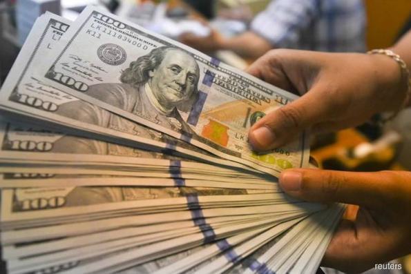 Dollar struggles near 2-mth lows, yen sags on receding risk aversion