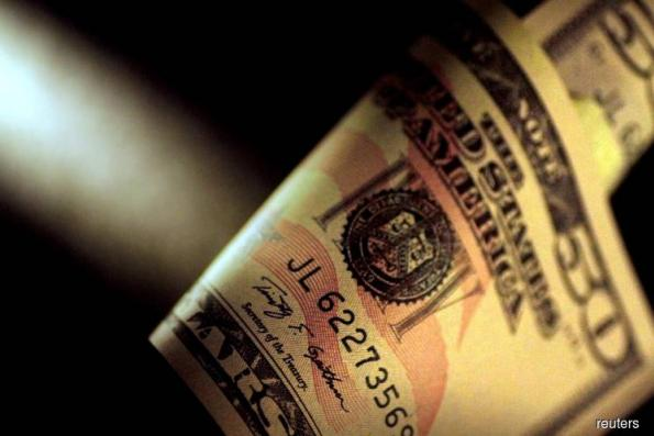 Dollar steady in safe-haven trade, sterling gains slightly on Brexit deal news