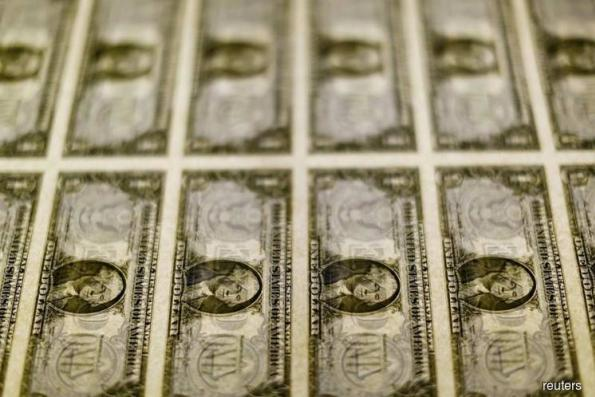 Dollar steady as global growth worries bolster safe-haven assets