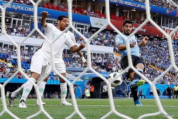 Uruguay makes knockout stage, Saudi Arabia out after 1-0 loss