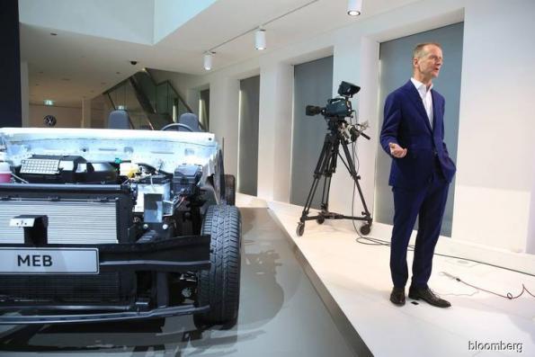 VW ups EV push to 22 mil cars as Porsche, Audi slip