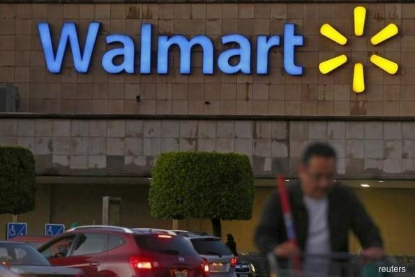 Walmart's US e-commerce growth rebounds, shares rise