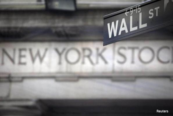 Wall St ends lower; Trump comments dampen sentiment late
