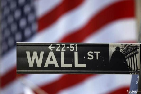 Tech, transports drag on Wall Street; Dow hits record