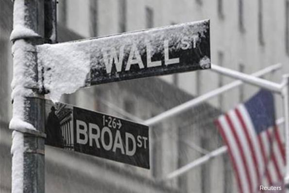 Wall St lower as investors assess Fed's hawkish stance