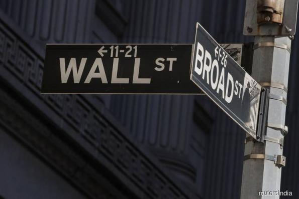 FedEx outlook weighs on Wall St ahead of Fed policy decision