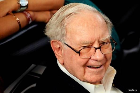 Apple hits record high after Buffett's Berkshire increases stake
