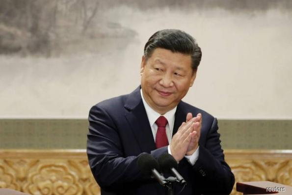 Ahead of Lunar New Year, China's Xi says will banish 'ghost' of poverty