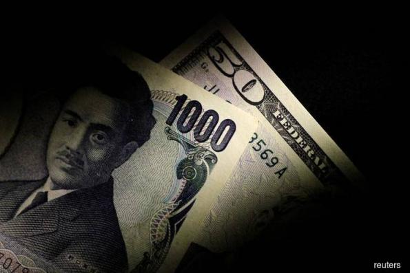 Dollar holds firm against yen, major peers on strong U.S. inflation