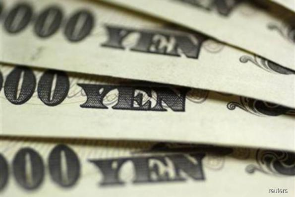 Yen climbs to 15-month high, hitting Japan stocks: Bloomberg markets wrap