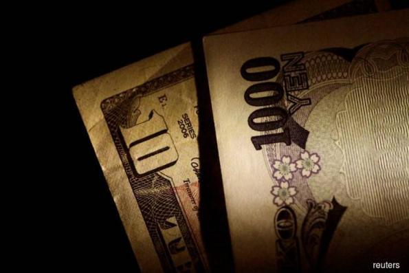 Dollar hits fresh 4-month high vs yen as U.S.-China trade war fears recede