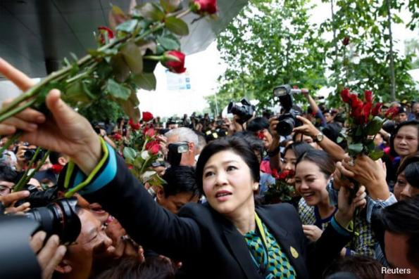 Thai court issues second arrest warrant for fugitive former PM Yingluck