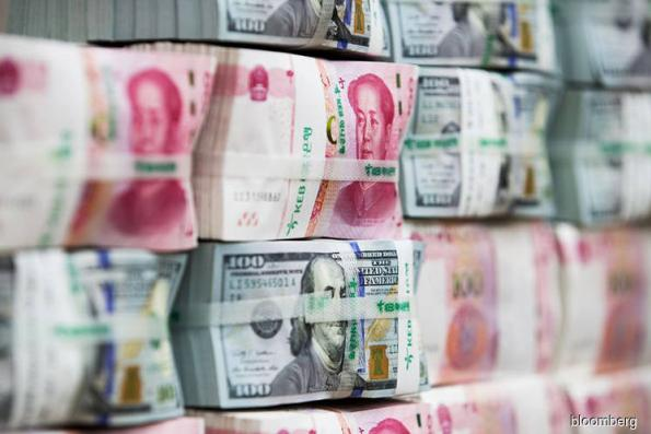 China's yuan defies dismal economy to head for six-month high