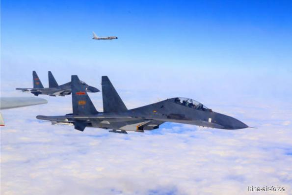 "China air force again circles Taiwan in ""sacred mission"""