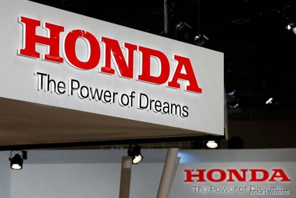 Honda sees lower annual profit as firm yen offsets higher sales