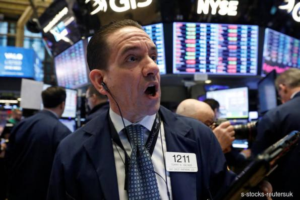 Wall St slides as strong dollar, trade fears trigger risk aversion