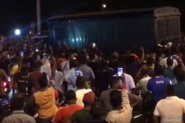 Number of people arrested over temple riots rises to 30