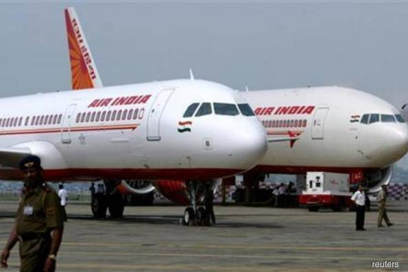 Modi said to keep out US$4.7 bil debt before Air India sale