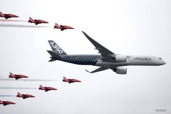 Planemakers plot course through trade, Brexit worries to air show deals