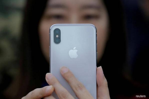 ITC to review ruling on Qualcomm's request for iPhone ban