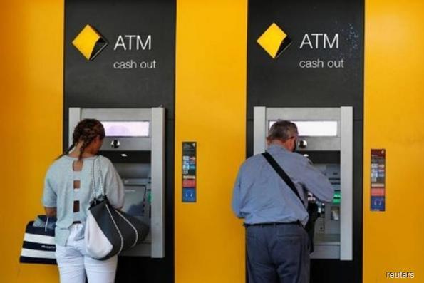 Australia's Commonwealth Bank Q3 profit falls 2 pct as charges mount