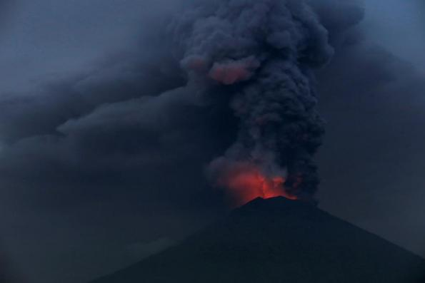 Ash from Bali volcano shuts airport; passengers stranded, villagers flee