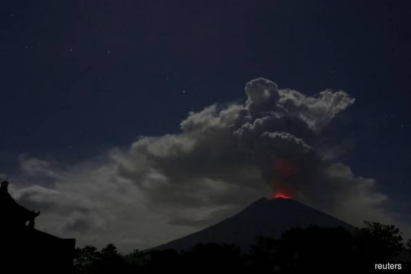 Bali airport reopens as volcano rumbles