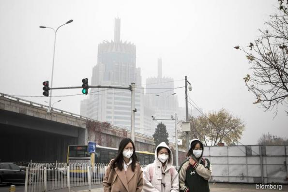 Beijing's worst air in more than year engulfs buildings in smog