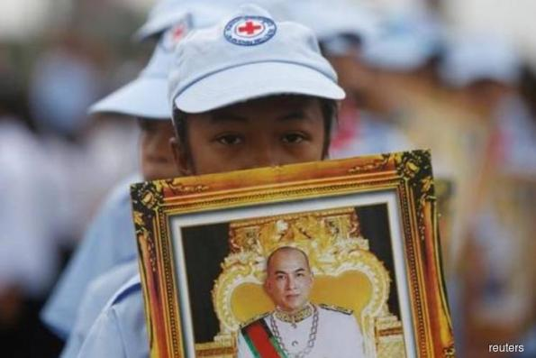Cambodia parliament adopts lese-majeste law, prompting rights concerns