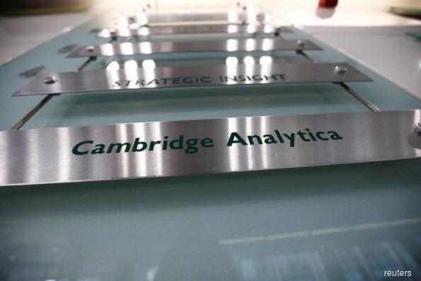 UK parliamentary committee summons former Cambridge Analytica boss