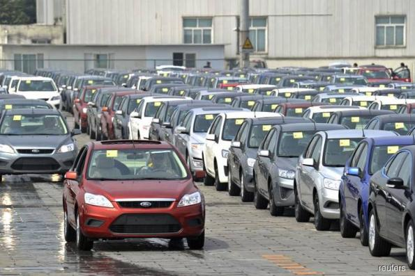 China to stop production of 553 vehicle models over fuel use