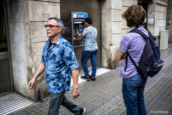 CaixaBank, Sabadell say business normal after calls to pull cash