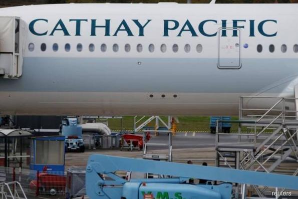 Cathay Pacific narrows losses on higher air fares, flags better 2H