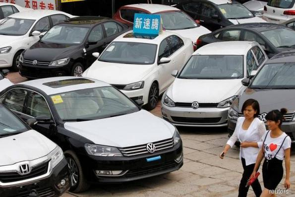 China sets timeline to scrap foreign stake limits for auto sector