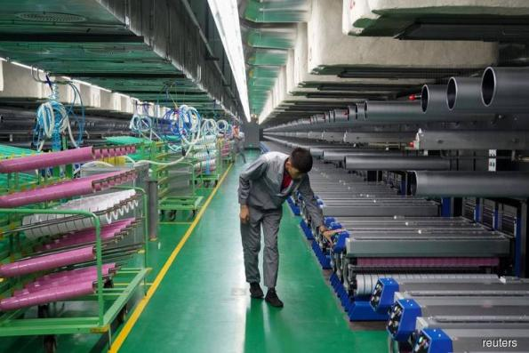 China's July factory growth slows on trade frictions, bad weather