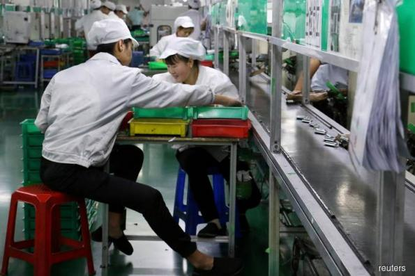 China industrial output, investment beat forecasts; retail sales miss