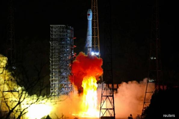 China 'lifts mysterious veil' by landing probe on dark side of the moon