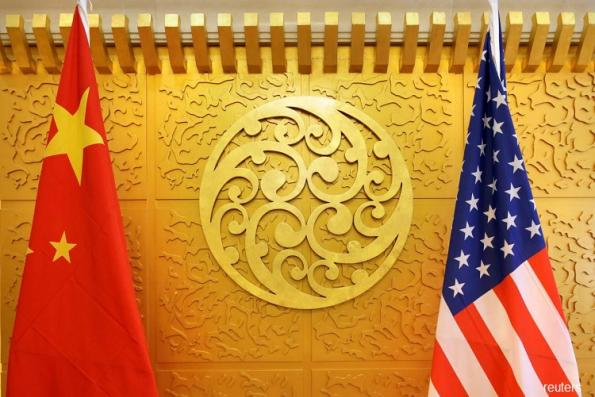 China says trade talks with US made progress on forced tech transfers, IP rights