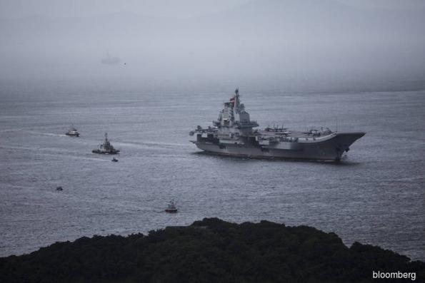 As Trump focuses on North Korea, China pushes into West Pacific